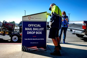 City of Redlands work crews install a ballot drop box in front of a Police Department building at the city's corporate yard on Thursday morning in Riverside on Oct. 1, 2020. Secure boxes will be located across the county and are one way for voters to return their ballots. Photo by Watchara Phomicinda, The Press-Enterprise/SCNG