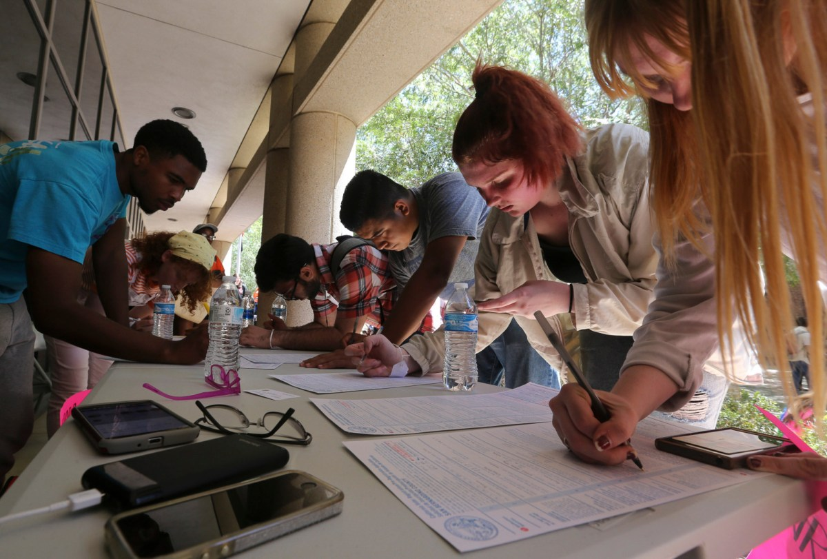 Students register to vote outside Rancho Cucamonga City Hall during a rally against gun violence on Friday, April 20, 2018 in Rancho Cucamonga. Photo by Stan Lim, Inland Valley Daily Bulletin/SCNG