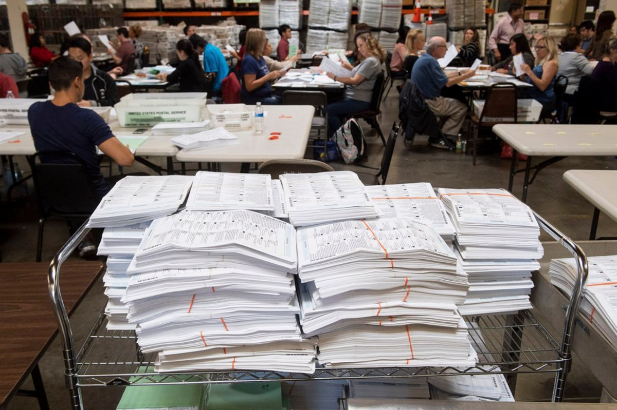 Which ballots get counted first? Stacks of California mail-in ballots await counting in this November 2018 file photo by Paul Bersebach, The Orange County Register/SCNG