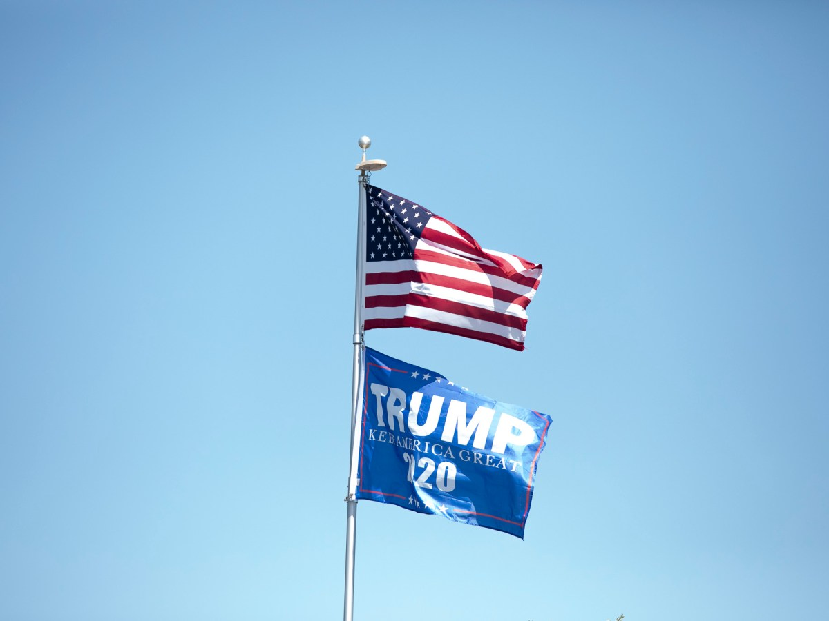 A Trump 2020 flag flies above homes in Oakdale, where approximately one third of the population identifies as latino, on May 6, 2020. Photo by Anne Wernikoff for CalMatters