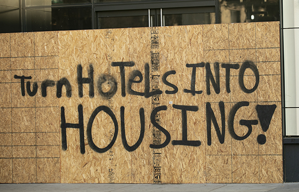 A sign in support of creating additional housing on a boarded up business in downtown Oakland on Nov. 5, 2020. Photo by Anne Wernikoff for CalMatters