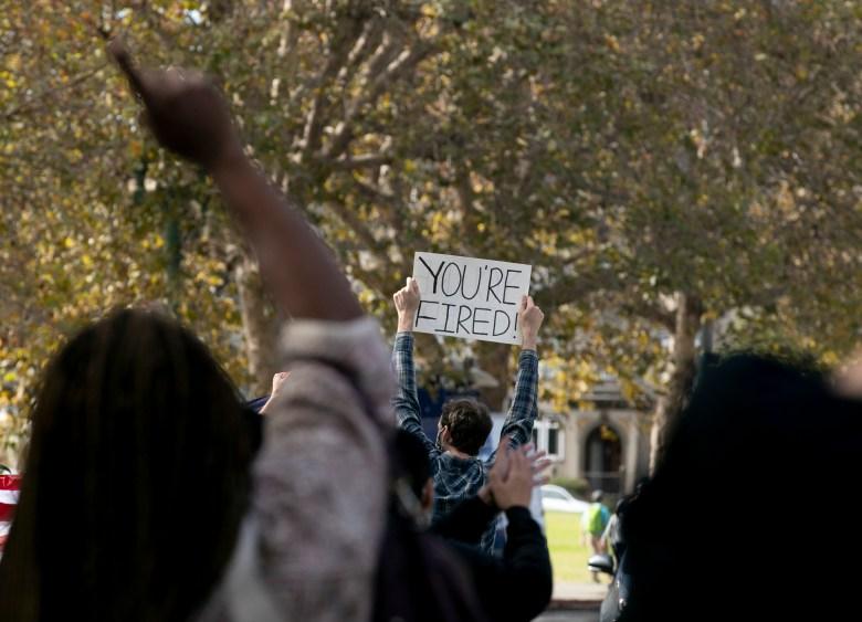 Hundreds gathered along Lake Merritt to celebrate Joe Biden and Kamala Harris' win over Donald Trump in Oakland on Nov. 7, 2020. Photo by Anne Wernikoff for CalMatters