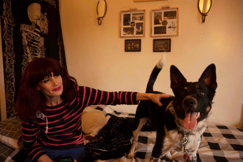 Stephanie Moore and her eight-month-old dog,Spook, in their Lawndale apartment, on Nov. 17, 2020. Photo by Tash Kimmell for CalMatters.