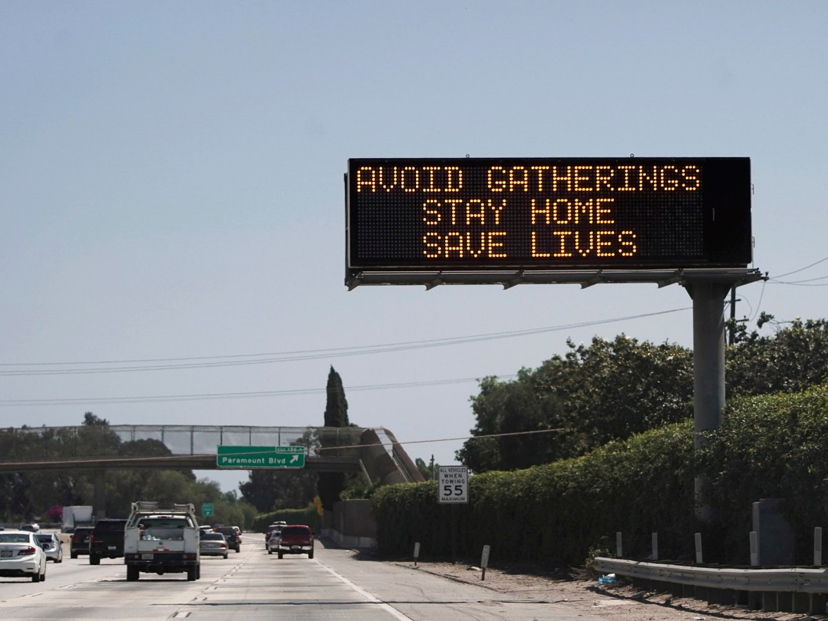 "A message board on Interstate 5 South with the words ""Avoid Gatherings. Stay Home. Save Lives."" on May 2, 2020 in Downey. Today, Gov. Gavin Newsom announced a new curfew order in response to growing concern over a new wave of COVID infections. Photo by Kirby Lee via AP"
