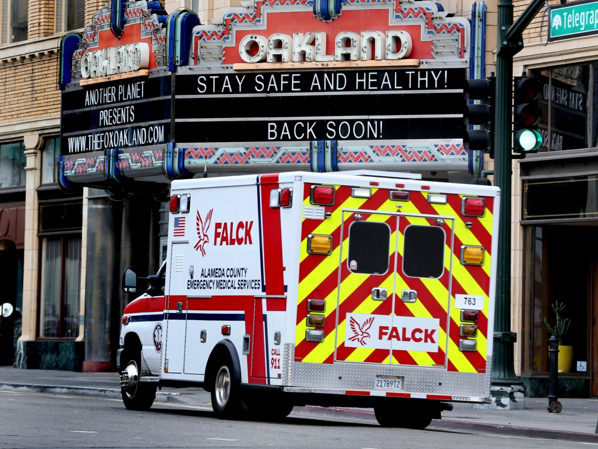 An ambulance rides past the Oakland Fox Theater on Telegraph Avenue in Oakland during the first shelter-in-place order on March 24, 2020. Photo by Ray Chavez, Bay Area News Group