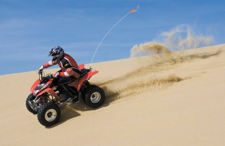 Nathan Sedlaczek, 13, rides a quad with his family at Oceano Dunes SRVA on March 24, 2014. Photo by David Middlecamp, San Luis Obispo Tribune