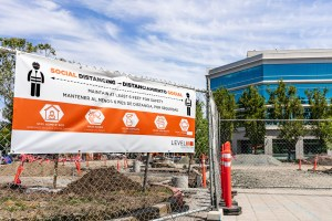Social Distancing rules meant to protect against the transmission of COVID-19, in English and Spanish, displayed at the entrance to a commercial construction site in Sunnyvale on May 10, 2020. California does not make workplace COVID-19 case data available to the public. Photo by Andrei Stanescu via iStock