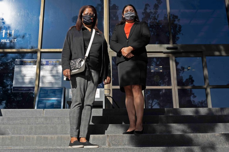 Attorney, Nathaly Medina and her client Lynn Byers stand in front of the Stanley Mosk courthouse in down town Los Angeles, on Dec. 2, 2020. Photo by Tash Kimmell for CalMatters