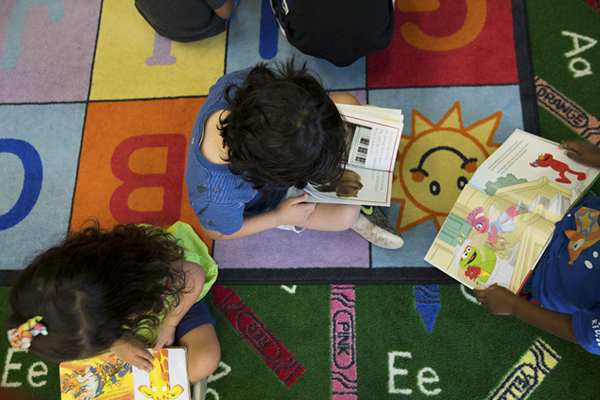Preschoolers read on the carpet at Galileo Preschool in San Jose on Aug. 20, 2018. Photo by Randy Vazquez, Bay Area News Group