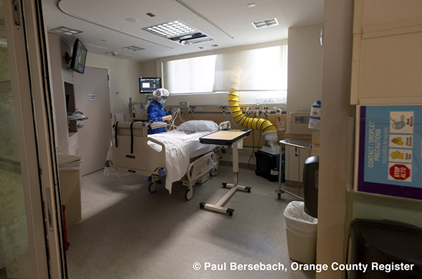 Birgitta Ouni, RN, prepares a room for a patient in the Critical Care Unit at St. Jude Medical Center in Fullerton on December 1, 2020. Photo by Paul Bersebach, Orange County Register/SCNG