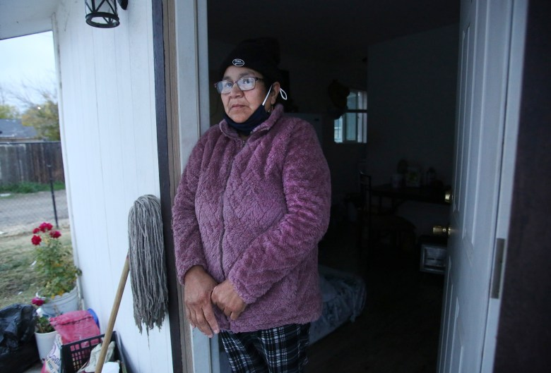 Maria Reyes has COVID-19 and is quarantining at her home in Mendota on Dec. 12, 2020. Photo by Gary Kazanjian