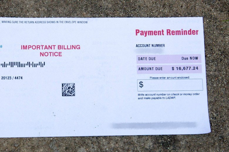 A copy of Deborah Bell-Holt's December utilities bill. Since then, she used stimulus checks to pay off $2,000, leaving her total utilities debt at nearly $15,000. Photo by Shae Hammond for CalMatters