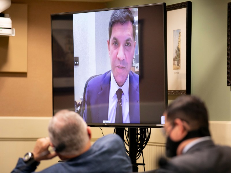 Assemblymembers listen as Faiz Ahmad, Bank of America managing director of transaction services, makes opening comments during a budget subcommittee hearing on unemployment insurance on Jan. 26, 2020. Photo by Anne Wernikoff, CalMatters