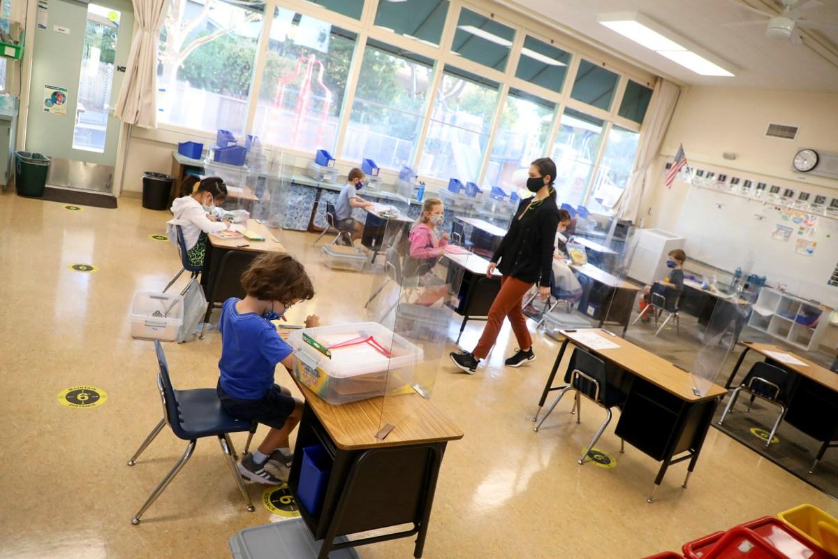 Kindergarten teacher Jessica Clancey, center, walks through her classroom at Barron Park Elementary School on Monday, Oct. 19, 2020 in Palo Alto. Photo by Aric Crabb, Bay Area News Group