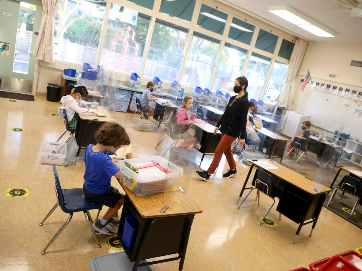 Kindergarten teacher Jessica Clancey, center, walks through her classroom at Barron Park Elementary School on Monday, Oct. 19, 2020 in Palo Alto. Photo by Aric Crabb, Bay Area News Group