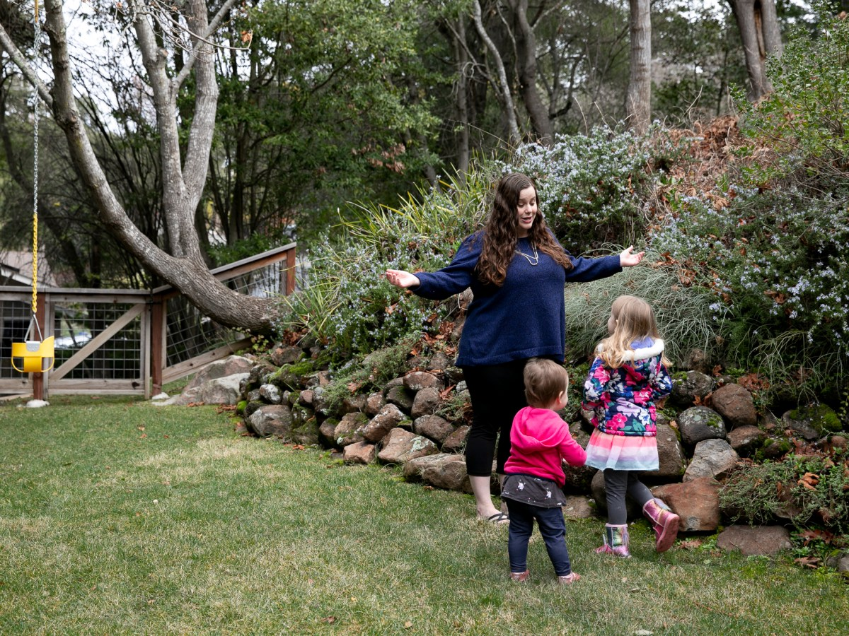 Gennie Gorback, President-Elect of the California Kindergarten Assocation, plays with her daughters, Cece, almost two, left, and Tilly, 4, right, at their Orinda home on Feb. 3, 2021. Photo by Anne Wernikoff, CalMatters