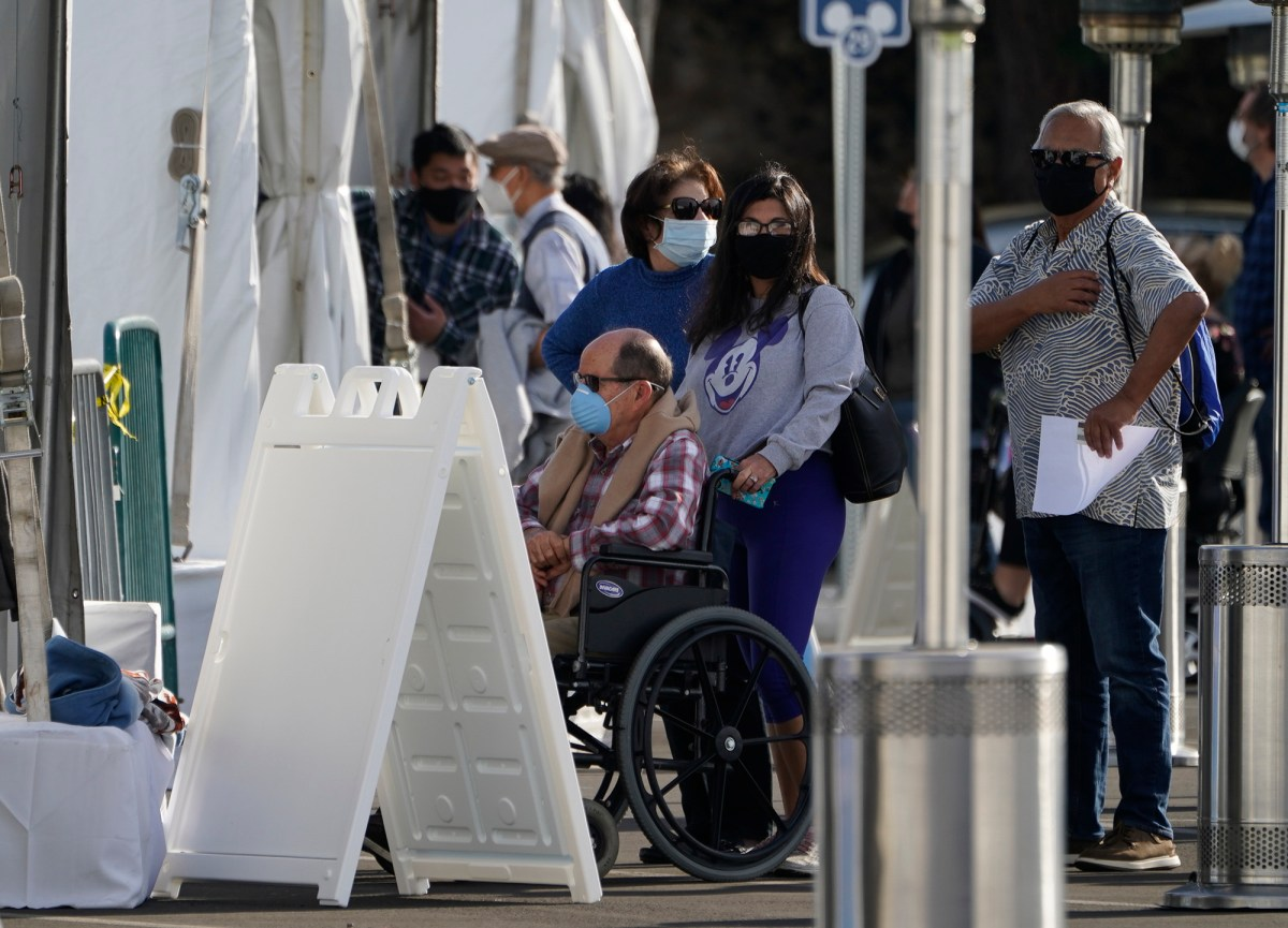 Orange County residents wait in line outside tents for a COVID-19 vaccine at the Disneyland Resort in Anaheim Jan. 13, 2021. Advocates had hoped a state panel would give higher COVID vaccine priority to disabled Californians. Photo by Damian Dovarganes, AP Photo