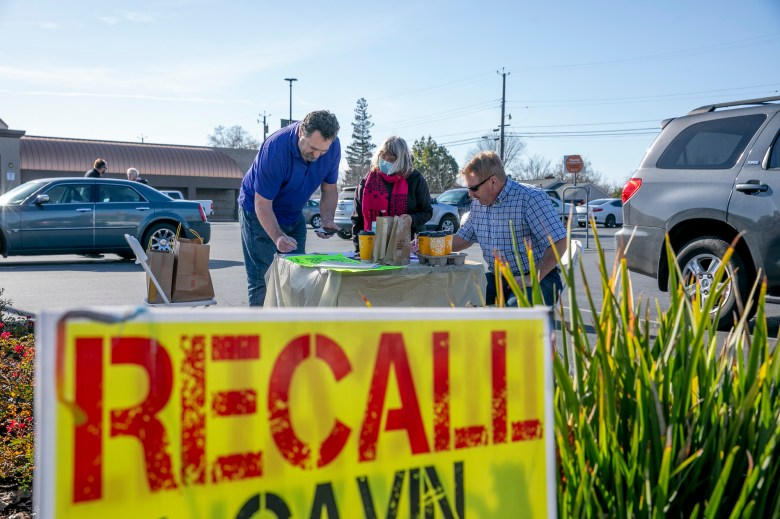 Recall supporters sign the petition at during a petition signing event at SaveMart in Sacramento on Jan. 5, 2021. Photo by Anne Wernikoff, CalMatters