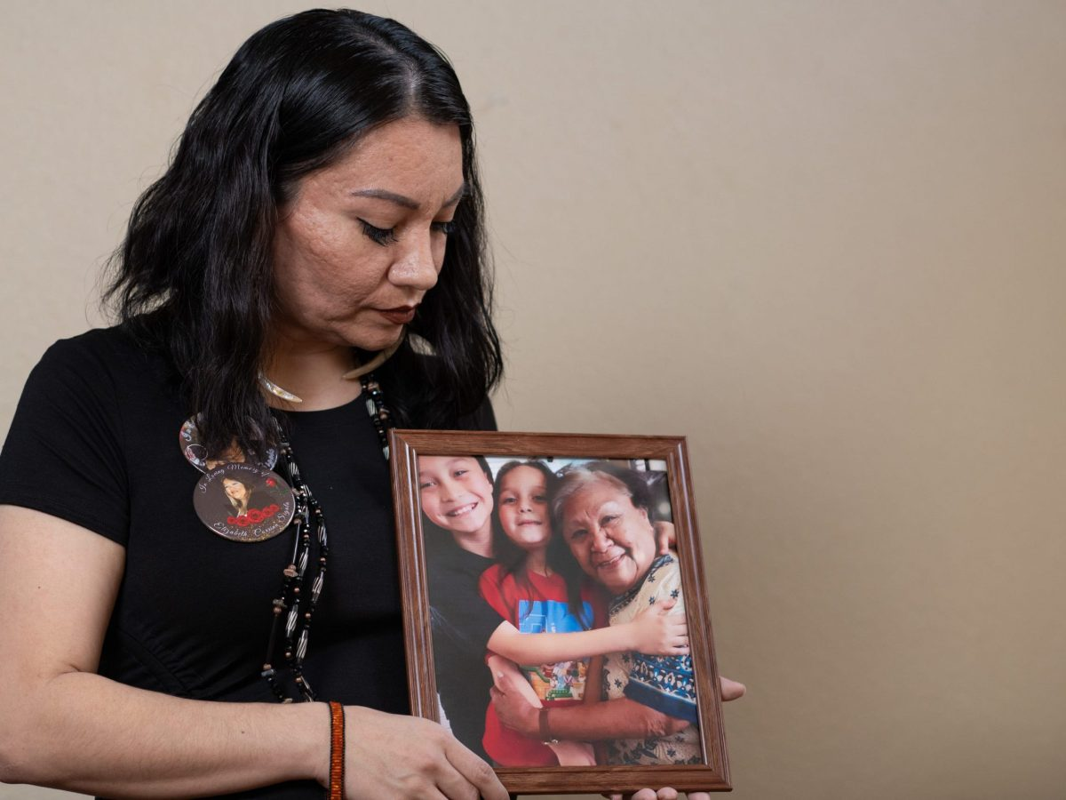Leticia Aguilar poses for a portrait holding a picture of her grandmother Betty Ann Sigala in her home in Elk Grove. Photo by Salgu Wissmath, USA Today