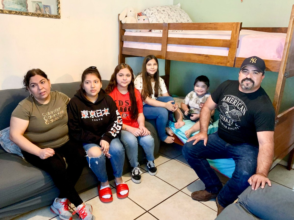 Yadira Michel, far left, Alonso Ceceñas, far right, and their four children with whom they share a one-bedroom apartment in Los Angeles. Photo by Araceli Martínez Ortega