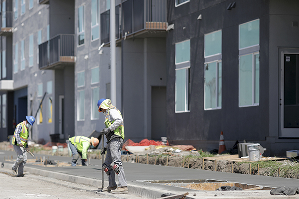 A construction crew works on a 290-unit transit-oriented mixed use affordable housing community with 7,200 sq. ft. of non-residential leasing space in Fremont. Photo by Anda Chu, Bay Area News Group