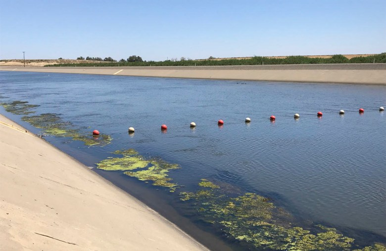 The California Aqueduct near Huron, CA in the San Joaquin Valley. Runoff carrying microplastics can pollute open channels like one which provides much of the imported water to the Metropolitan Water District. Photo by Michelle Sneed, US Geological Survey