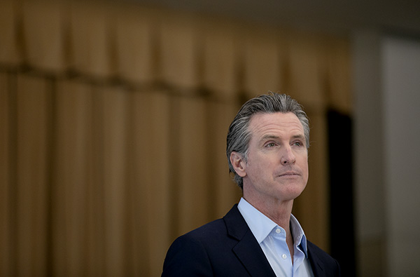 Gov. Newsom listens to reporter questions during a press conference at Ruby Bridges Elementary school in Alameda on March 16, 2021. Photo by Anne Wernikoff, CalMatters