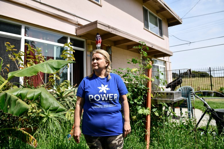 Daisy Vega, president of the resident advisory council at the Mar Vista Gardens public housing complex, poses for a portrait in her front yard on April 14, 2021. Photo by Pablo Unzeuta for CalMatters