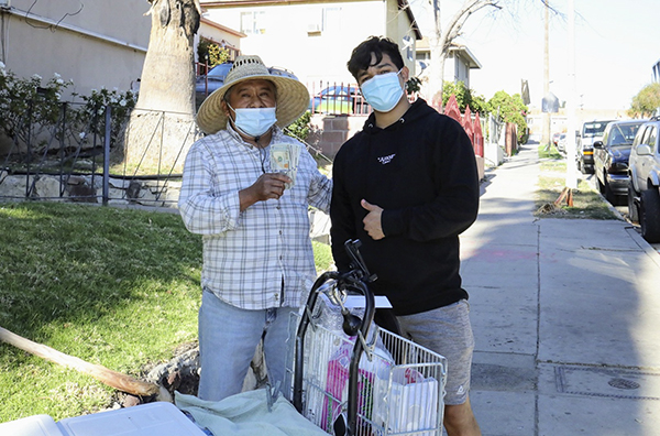 Jesus Morales, who goes by Juixxe on TikTok, raises donations from followers that he shares with street vendors in Los Angeles. Photo courtesy of Jesus Morales