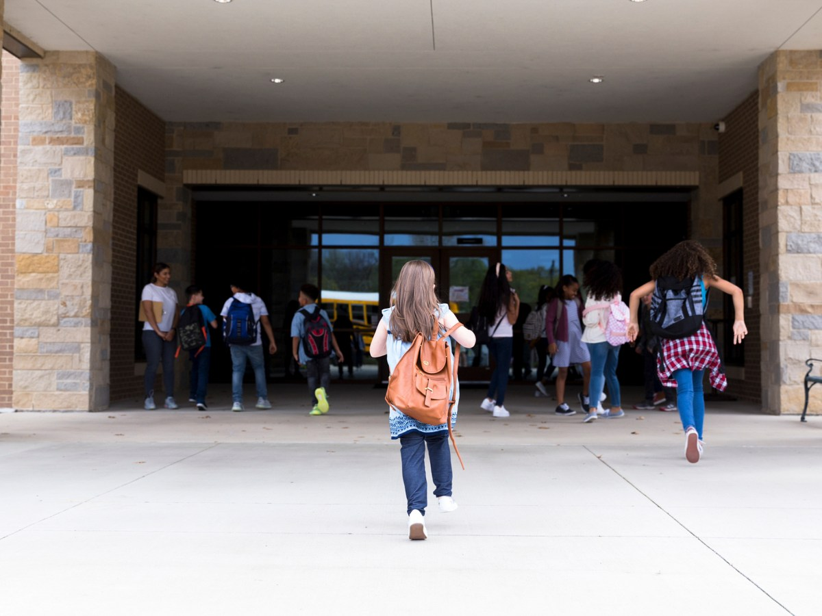 A student runs into a school building. Amid a recall campaign, Gov. Gavin Newsom and challenger Kevin Faulconer are rolling out big plans. Image via iStock