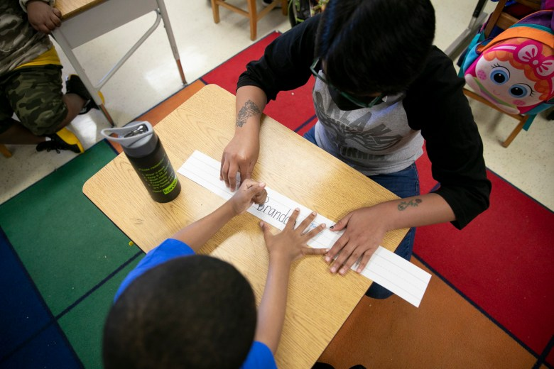 Rising first graders work on a spelling activity during summer school at Laurel Elementary on June 11, 2021. Classes focus on academics in the morning and hands on activities in the afternoon. Photo by Anne Wernikoff, CalMatters