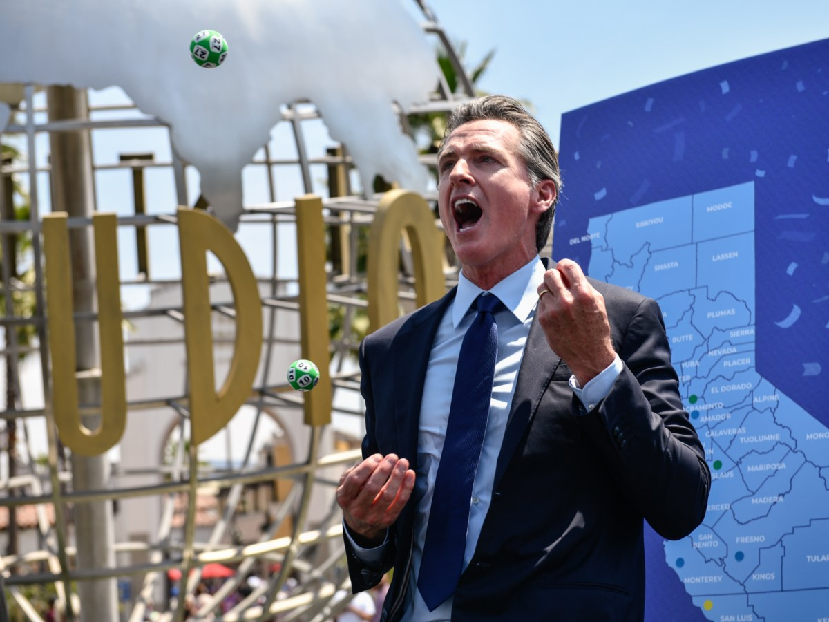 Gov. Gavin Newsom celebrated California's milestone with a lottery-style selection of 10 winners who will be endorsed $1.5 million each for being fully vaccinated, making it the nation's largest incentive for the coronavirus vaccine. After the news conference, Newsom juggled the lottery balls Photo by Pablo Unzueta for CalMatters