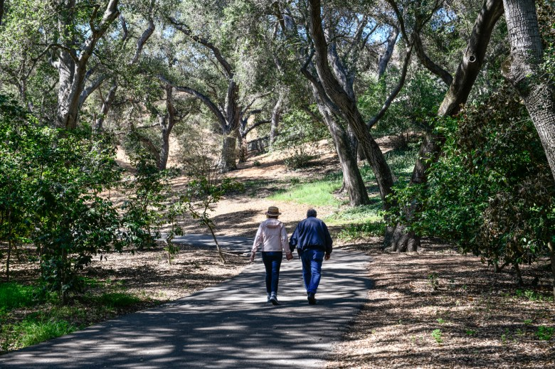A couple hold hands during a morning walk at Descanso Gardens in La Cañada Flintridge, on June 22, 2021. Pablo Unzueta for CalMatters