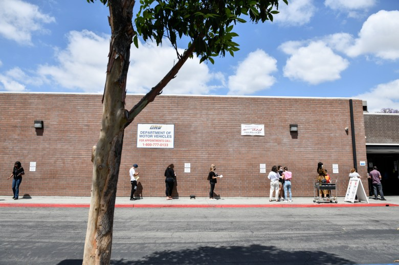 People wait in line outside of the state Department of Motor Vehicles office in Bellflower, on June 8, 2021. Pablo Unzueta for CalMatters