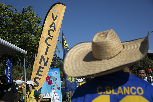 Fans walk past a vaccination pop-up during an event sponsored by the California Department of Public Health to increase vaccine awareness at a Club America vs. Atlas FC soccer Match at PayPal Park on July 7, 2021 in San Jose. Photo by Anne Wernikoff, CalMatters