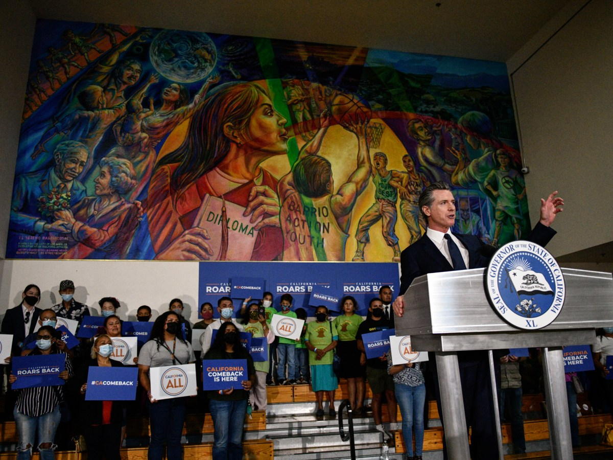 Gov. Gavin Newsom delivers a speech during a rally at the Barrio Action Youth and Family Center in El Sereno, where he would sign the California Comeback Plan relief bill, on July 13, 2021. Pablo Unzueta for CalMatters