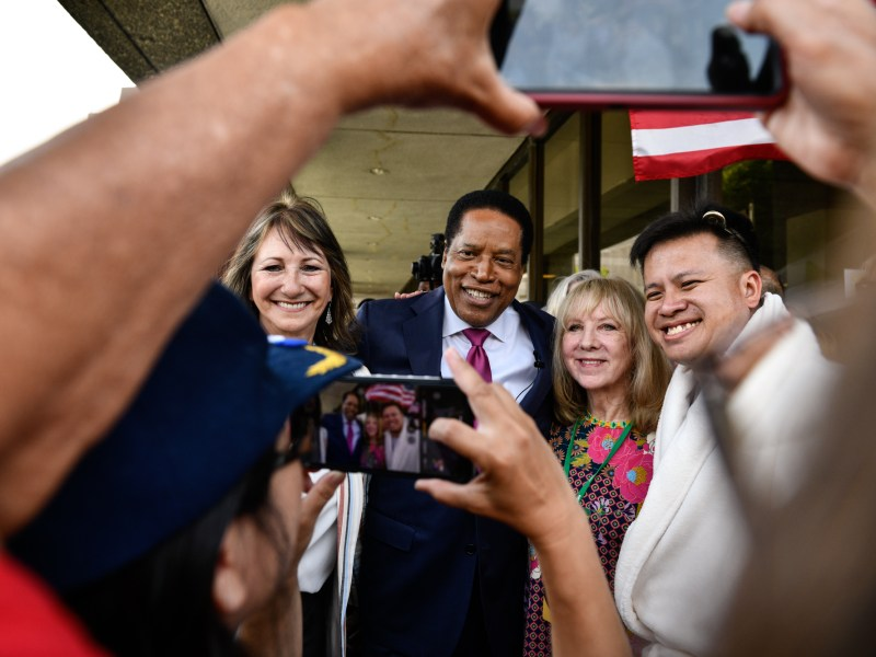 Conservative radio talk show host Larry Elder, takes pictures with his supporters during a rally in Norwalk, on July 13, 2021. Elder announced his bid as a recall candidate for governor of California. Pablo Unzueta for CalMatters
