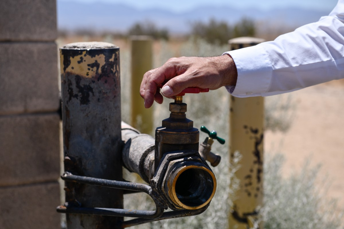 The vandalized water source where most water thefts occur in Lancaster, on July 2, 2021. The water is pumped into large containers that are sold and bought on the sides of the road. Pablo Unzueta for CalMatters