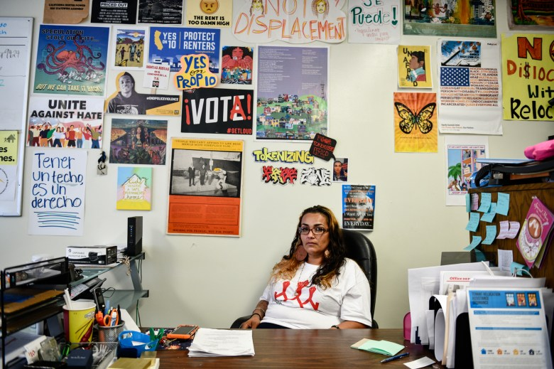 """Cynthia Macias, board president of Housing Long Beach, sits inside her office in Long Beach, on July 23, 2021. """"I don't do it for the money, I do it because I want to help people,"""" Macias said. Photo by Pablo Unzueta for CalMatters"""