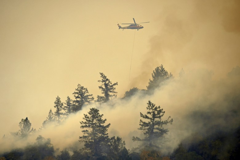 A helicopter drops water while battling the Glass Fire in St. Helena on Sept. 26, 2020. Photo by Jose Carlos Fajardo, Bay Area News Group
