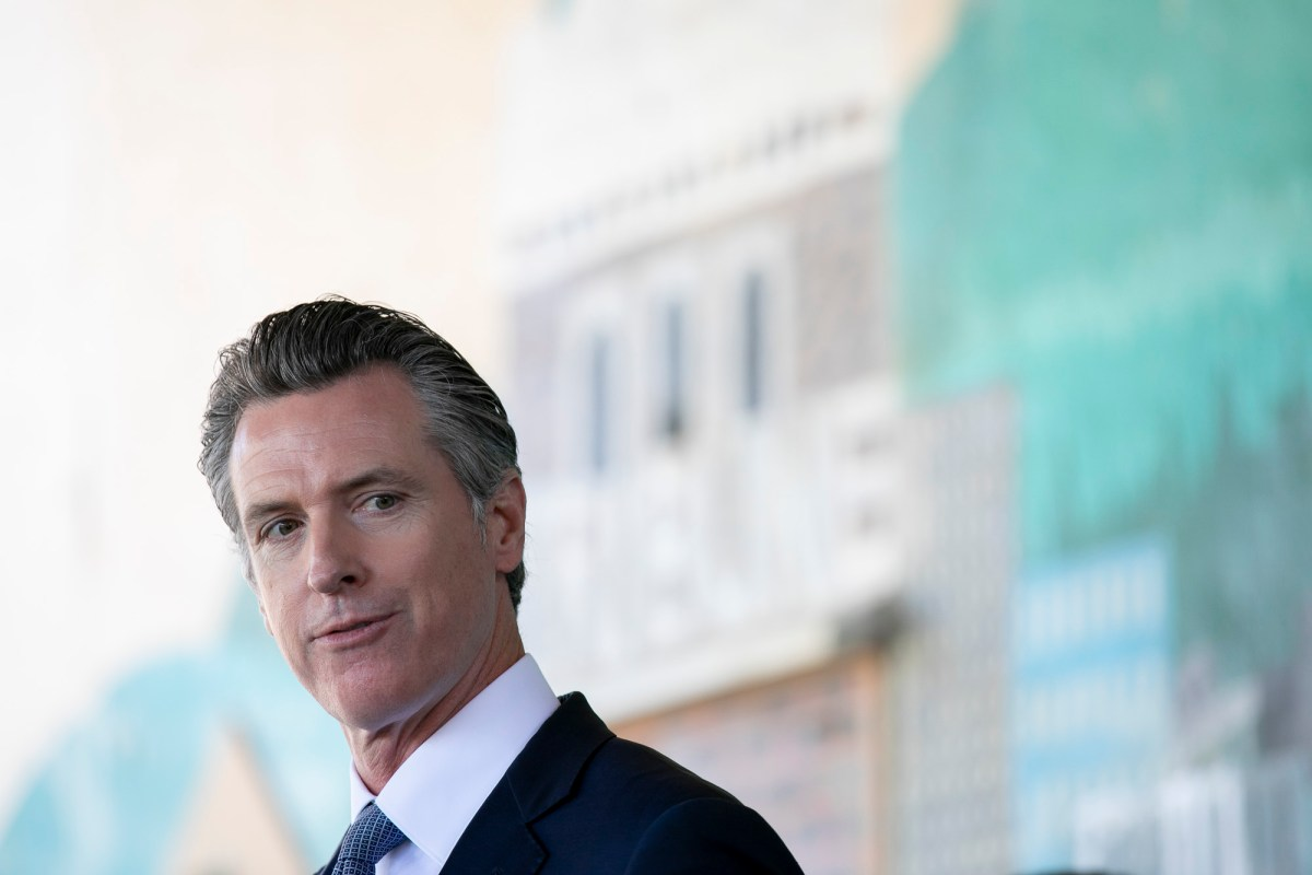 Gov. Gavin Newsom, facing a recall, prepares to speak at a press conference to announce a new requirement for all school teachers and employees to show proof of vaccination or to undergo weekly COVID-19 testing, at Carl B. Munck Elementary School in Oakland on Aug. 11, 2021. Photo by Anne Wernikoff, CalMatters