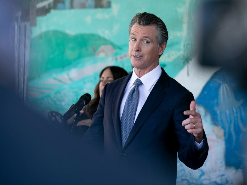 Gov. Gavin Newsom prepares to speak at a press conference to announce a new requirement for all school teachers and employees to show proof of vaccination or to undergo weekly COVID-19 testing, at Carl B. Munck Elementary School in Oakland on Aug. 11, 2021. Photo by Anne Wernikoff, CalMatters