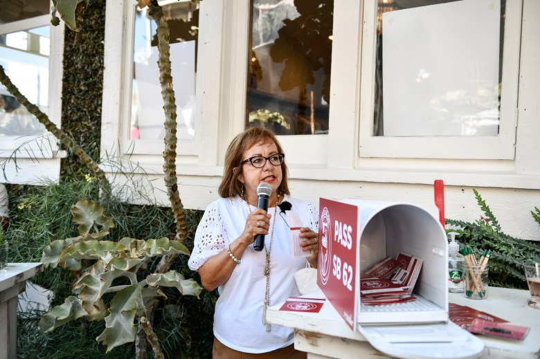 Sen. Maria Elena Durazo, the co-author of the SB62, the Garment Worker Protection Act, talks to supports during an event in Venice on August 12, 2021. Photo by Pablo Unzueta for CalMatters