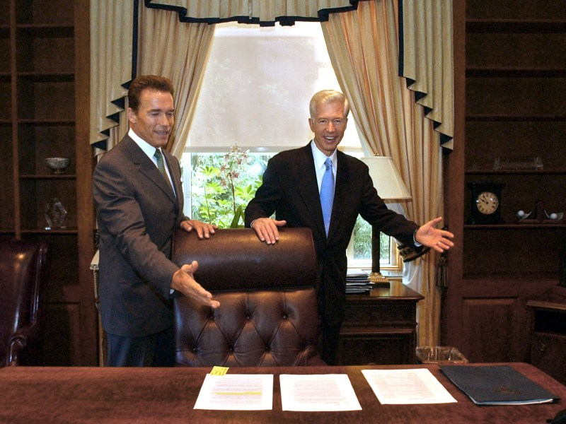 Gov.-elect Arnold Schwarzenegger, left, and Gov. Gray Davis joke with each other as Davis shows Schwarzenegger the governor's private office at the Capitol in Sacramento on Oct. 23, 2003. The two met for the first time since the election to go discuss the transition. Photo by . Rich Pedroncelli, AP Photo