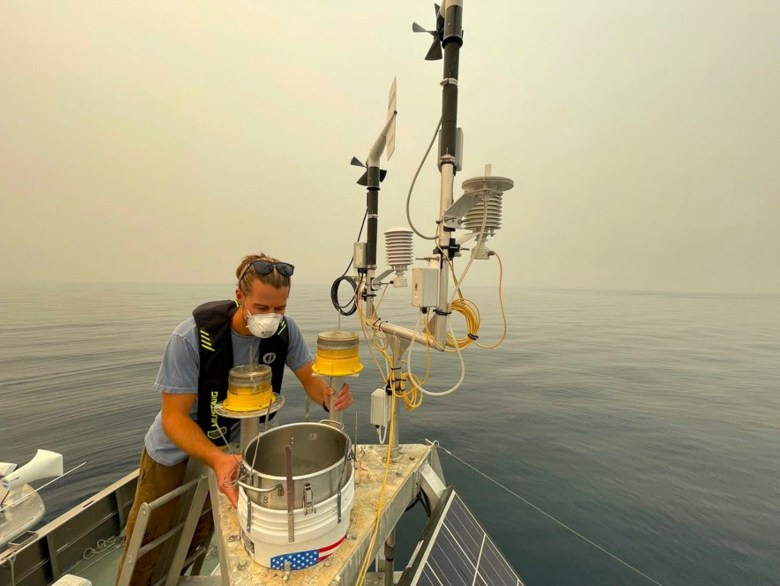 Researcher Brandon Berry replaces the particle deposition sampler on one of UC Davis' research buoys on Lake Tahoe on August 25, 2021. Photo by Brant Allen, UC Davis courtesy of S Geoffrey Schladow