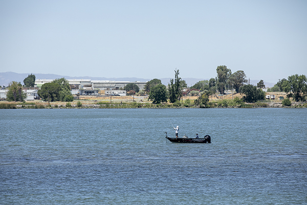 Boaters fishing on the Sacramento River outside of Rio Vista in Sacramento County on June 15, 2021. The state has notified 9,000 water users from Fresno to Sacramento to stop diverting water from the San Joaquin and Sacramento rivers watershed. Photo by Anne Wernikoff, CalMatters