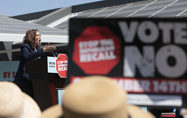 """Vice President Kamala Harris stumps for Gov. Gavin Newsom during a campaign rally encouraging Californians to vote """"no"""" on the recall election next week, at the IBEW-NECA training center in San Leandro on Sept. 8, 2021. Photo by Anne Wernikoff, CalMatters"""
