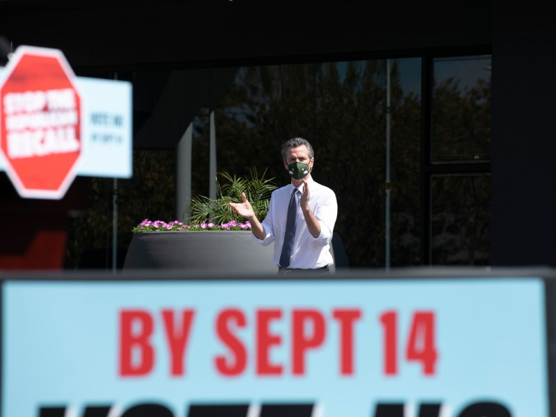 Gov Gavin Newsom walks toward the podium during a recall campaign event at the IBEW-NECA training center in San Leandro on Sept. 8, 2021. Gov. Newsom faces being recalled next week. Photo by Anne Wernikoff, CalMatters
