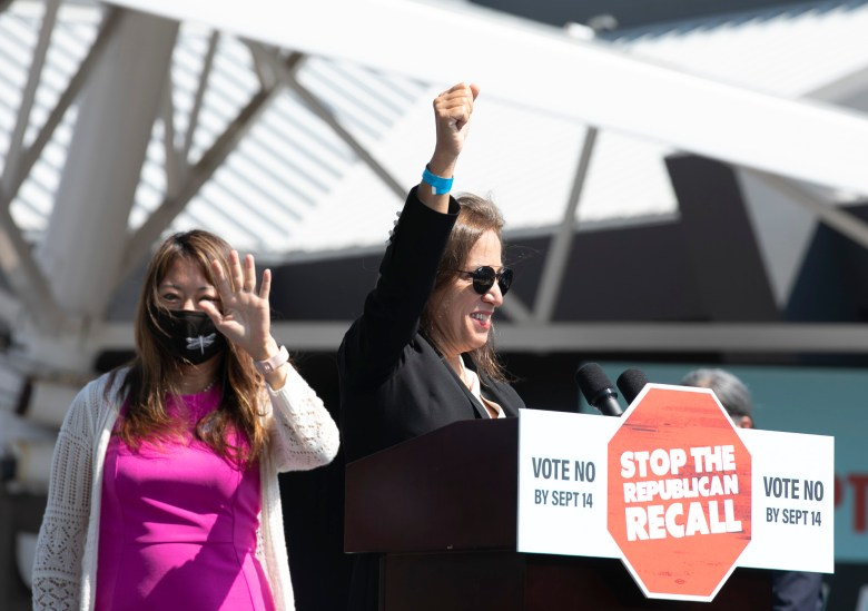 State Treasurer Fiona Ma, left, and Lt. Governor Eleni Kounalakis wave to the crowd during a rally in support of Gov. Gavin Newsom, who faces recall election, on Sept. 8, 2021. Ma and Kounalakis were both elected to state-wide office in 2018. Photo by Anne Wernikoff, CalMatters