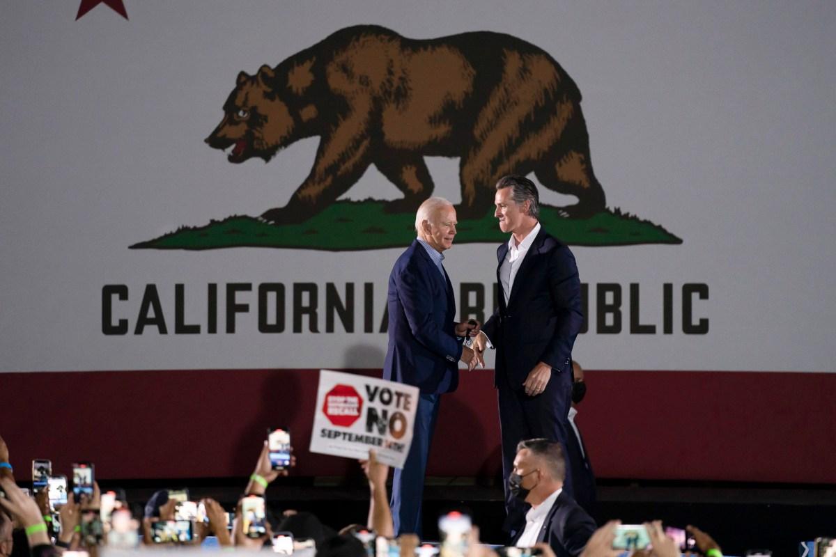 President Joe Biden and Gov. Gavin Newsom shake hands during a rally one day ahead of the California gubernatorial recall election, Sept. 13, 2021, in Long Beach. Photo by Jae C. Hong, AP Photo